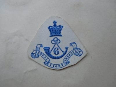 Embossed regimental badge on card- one example of several available