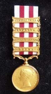 Indian Mutiny Medal with four clasps, a silver gilt glazed Royal Mint specimen.