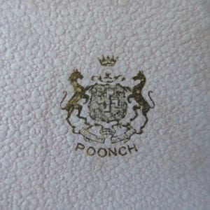 Poonch. The outer part of a greetings card embossed with the arms of Poonch in gold.