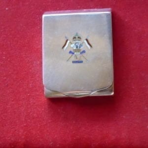 A 12th Lancers enamelled silver match book holder